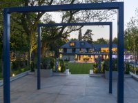 Hertingfordbury - View at dusk through Pergola from rear of garden towards house